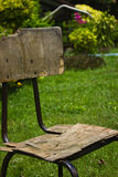 Old wooden chair. On green grass Royalty Free Stock Image