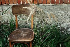 Free Old Wooden Chair And Grass In Backyard On Background Of Aged House, Calm Summer Moment, Space For Text Royalty Free Stock Images - 121587999