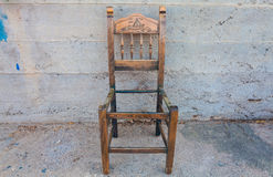The old wooden chair  on the background concrete wall Stock Photo