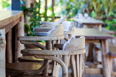 Old wooden chair in front of bar. Interior design, Old wooden chair non paint in front of bar Royalty Free Stock Image