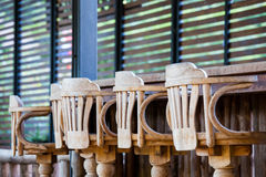 Old wooden chair in front of bar. Interior design, Old wooden chair non paint in front of bar Stock Image