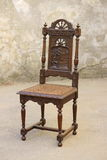 Old wooden chair furniture with carving Stock Photos