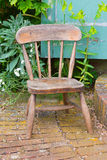 Old wooden chair in a garden Royalty Free Stock Images