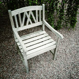 Old wooden chair in the garden Stock Photos