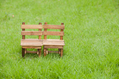 Old wooden chair and grass  on green background , Concept about Stock Photography
