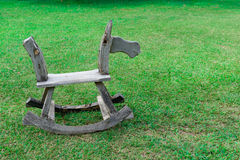 Old wooden chair on green grass Stock Photography