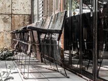 Old wooden chair Located in front of the old building. royalty free stock photography