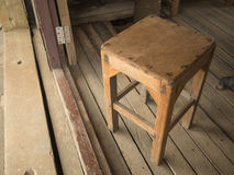 Old wooden chair. Placed in a room made of wood Stock Photo