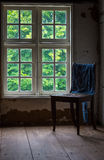The old and wooden chair in a room Royalty Free Stock Photo