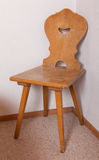 Old wooden chair at the room corner of old house, Switzerland Royalty Free Stock Photography