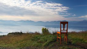 Old wooden chair on the top in Gerlitzen Alps. Inverse weather stock footage