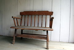 Old wooden chair. This old wooden chair was inside a shaded area. It seemed nice and peaceful and would be a great place to sit on a sunny day Stock Photography