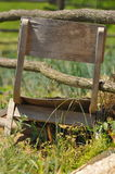 Old wooden chair in wild garden Royalty Free Stock Photo