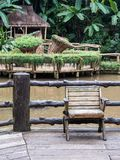 Old wooden chair on the wooden terrace. Royalty Free Stock Photos