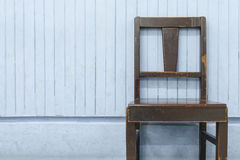 Old wooden chairs on blue wood wall. Background Stock Image