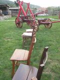 Old wooden chairs and wooden cart stock photo