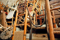 Old wooden chairs in grunge warehouse of old furniture Royalty Free Stock Images