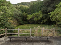 Old wooden chairs in Japaness garden and mountain veiw backgroun Stock Photos