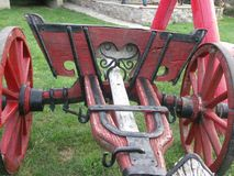 Old wooden chairs and red wooden cart royalty free stock photo