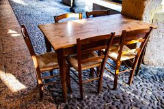 Old wooden chairs and table in a quiet restaurant stock photos