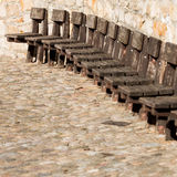 Old wooden chairs on wall Stock Photos