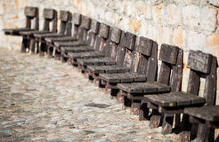 Old wooden chairs on wall Stock Photography