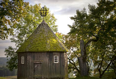 Old wooden chapel. Old dark wooden chapel in Kernave, Lithuania Stock Photos