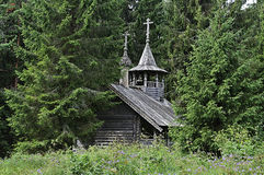 Old wooden chapel in the forest Stock Photo