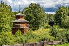 An old wooden chapel in a village cemetery. Kizhi Island, Onega Lake, Karelia. Russia royalty free stock photos