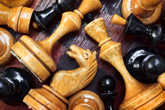 Old wooden chess pieces. Close up of an old wooden chess pieces Stock Photo