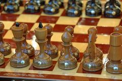 Old wooden chess. In the starting position Royalty Free Stock Photo