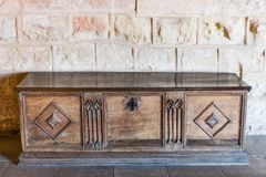 Old wooden chest in castle room. In Spain royalty free stock photo