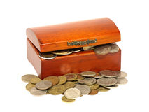 Old wooden chest is full of coins. Royalty Free Stock Photography