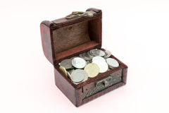 Old wooden chest with golden coins Stock Image