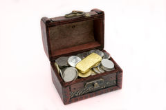 Old wooden chest with golden coins Stock Photography