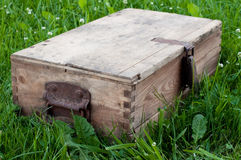 Old wooden chest. An old wooden chest on grass Stock Photo