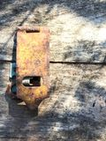 Old wooden chest with rusty padlock stock image