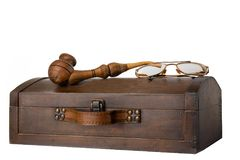 Old wooden chest with tobacco pipe and a pair of glasses on it i stock image