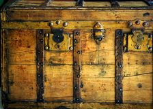 Old wooden chest, trunk in golden color. And rusty Royalty Free Stock Photography