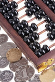 Old wooden Chinese Abacus and Chinese coins Stock Images