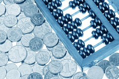 Old wooden Chinese Abacus and Chinese coins Royalty Free Stock Photo