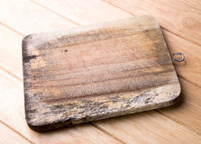 Old wooden chopping board. Royalty Free Stock Images