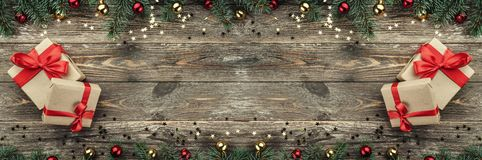 Free Old Wooden Christmas Background. Fir Branches With Baubles And Gold Stars. Xmas Horizontally Card, Gifts. Top View Stock Photography - 131540472
