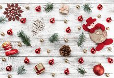 Old wooden Christmas background. Red and gold Baubles. Fir branches and cones. Xmas items. Top view. Horizontally Xmas card.  stock photos
