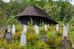 Old wooden church and cemetery Stock Image