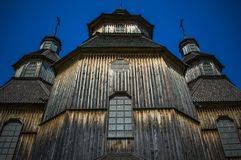 Old wooden church against the blue sky in Ukraine stock photography