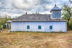 Ancient church and cemetery. Old wooden church and cemetery in village Balauresti from Moldova Royalty Free Stock Image