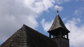 Old wooden church and clouds Stock Images