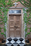 Old wooden  church door in the garden. Royalty Free Stock Photography