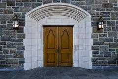 Old wooden Church doors with stonework. And surrounded by marble Royalty Free Stock Photo